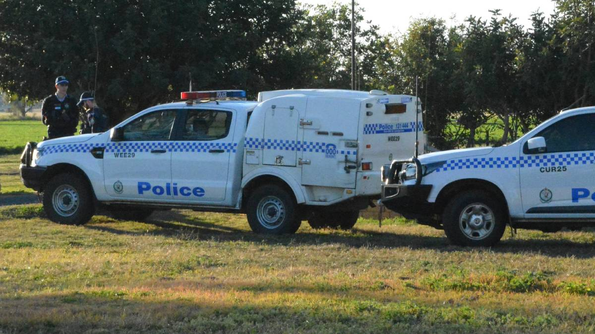 Crime scene guard: Oxley police cordoned off the property on the outskirts of Gunnedah on Wednesday after the young girl's body was discovered. Photo: ACM