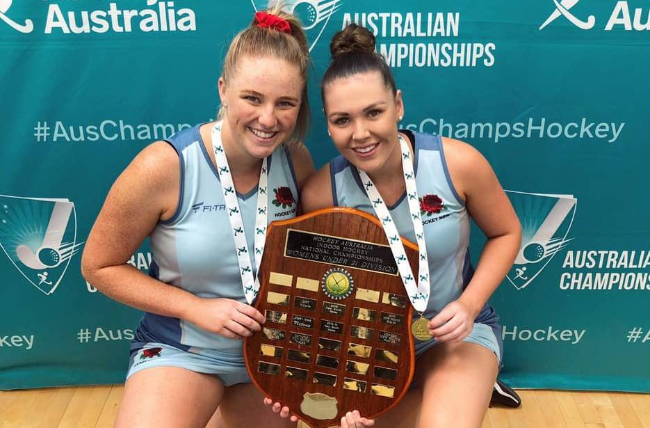GOLDEN GIRLS: Orange's Chloe Barrett and Dubbo's Emma Corcoran celebrate their national title win with NSW. Photo: CONTRIBUTED