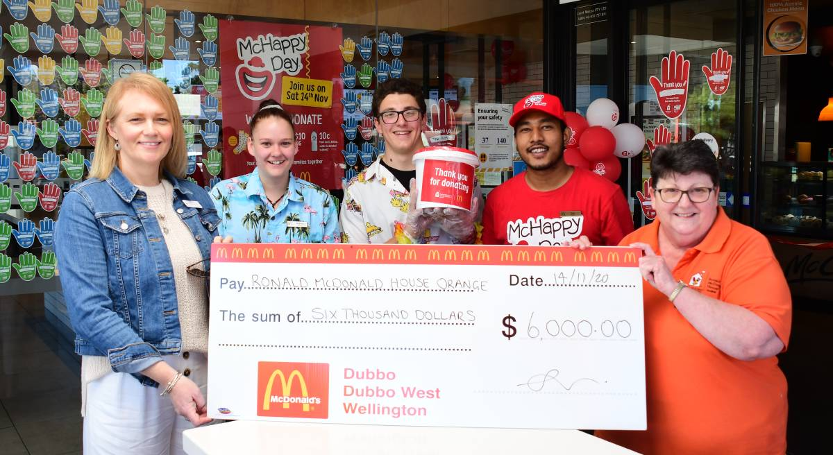 HANDOVER: Bronwyn Cooper with Wyatt Schubel, Brittany Regan, Sujit Shretha and Narelle Gordon. Photo: BELINDA SOOLE.
