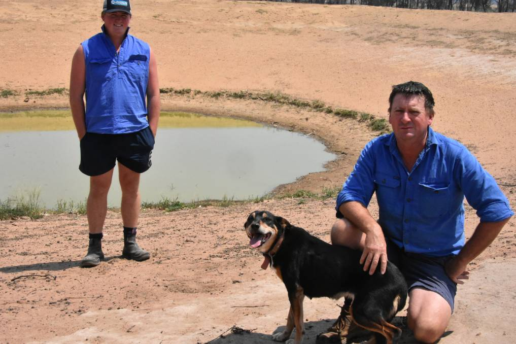 EXTREMELY DRY: NSW Farmers vice president Chris Groves inspecting one of the last dams on their Cowra property holding water.