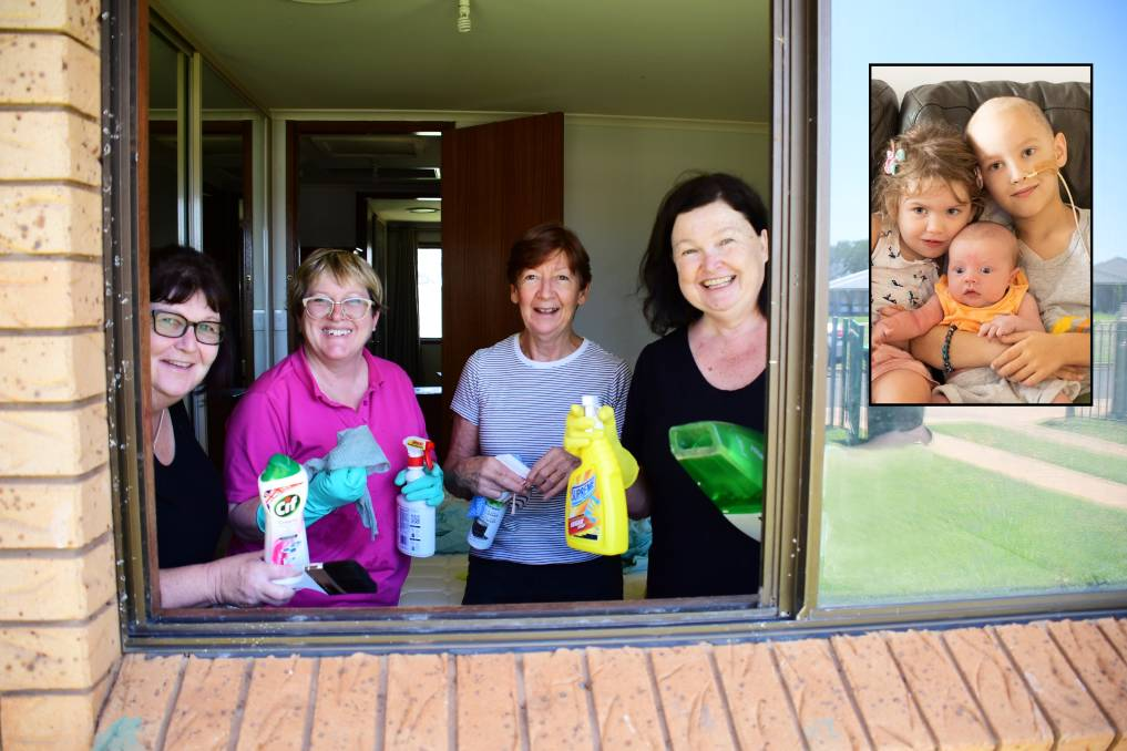 CLEANING: Terri-Ann Kelly, Lyn Griffiths, Barb Taylor and Nettie Williams clean the Ray family's home. Insert: Hannah, Connor and Mitchell Ray in March. Photo: BELINDA SOOLE