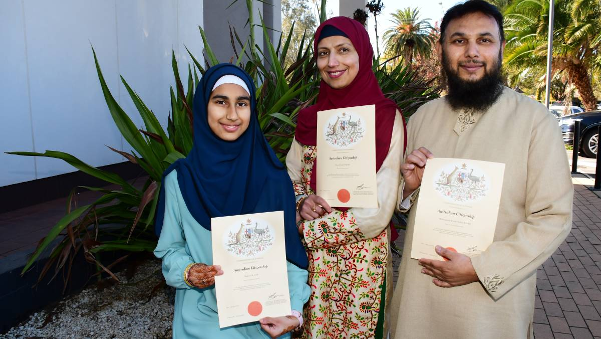IMPORTANT DAY: Nabeera Khan with her mother Fizzahashif and father Muhammad Kashif after they became citizens. Photo: BELINDA SOOLE