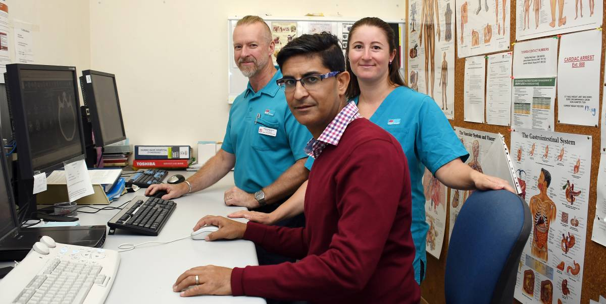COLLABORATION:  Bathurst Hospital senior CT radiographer Peter Traise, Dubbo Hospital radiologist Dr Rony Kapoor and Dubbo Hospital senior radiographer Vanessa Carter confer on the RAPID software. Photo: BELINDA SOOLE