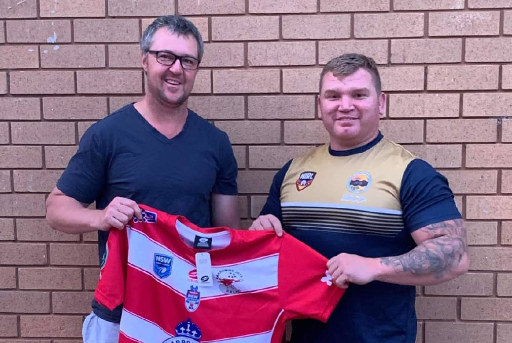 BACK IN RED AND WHITE: Luke Thompson (right), pictured with Jets president Mick Burns, is one of a number of new signings at Narromine. Photo: NARROMINE JETS