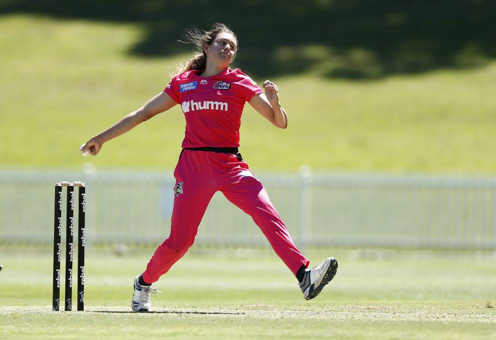 GAME TO REMEMBER: Emma Hughes took a wicket in her Sixers debut on Sunday. Photo: GETTY IMAGES via SYDNEY SIXERS