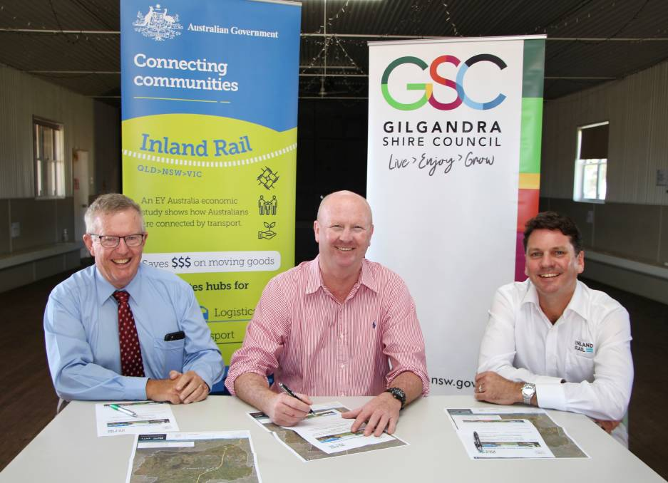 Member for Parkes Mark Coulton with Gilgandra Shire Council acting mayor Ash Walker and Inland Rail's Duncan Mitchell.