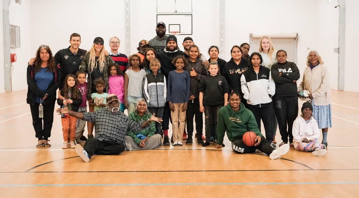 NEW LEAGUE: NBA Star Patty Mills surrounded by fans during a stop in South Australia. PHOTO: CONTRIBUTED.