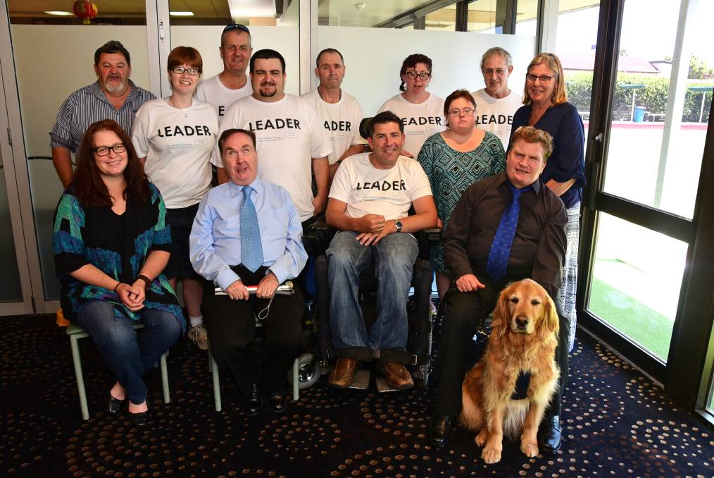 Enjoying a celebratory lunch at the Sporties Club in Dubbo on Monday were (back) Ross Bailey, Gabby Husband, Nick Brandon, John Ballingall, Stephen Grant, Shane Lipari, Kylie Coffee, Sarah Bowkett, Peter Fraser, Dianne Bowkett (front) Kim O'Donnell, Maurice Gleeson, Nick Gleeson and Unity (companion).										      Photo: BROOK KELLEHEAR-SMITH