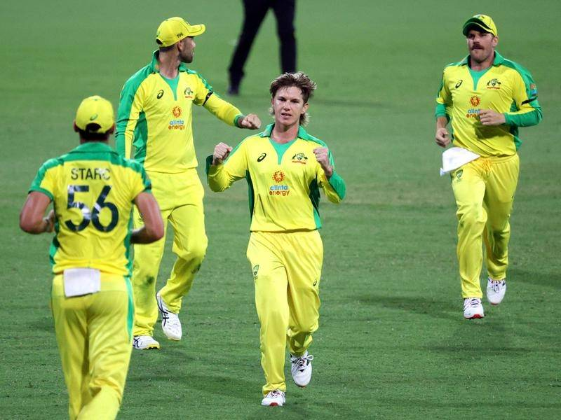 Adam Zampa (c) says the slow over-rate will improve as players get back in the swing of things.