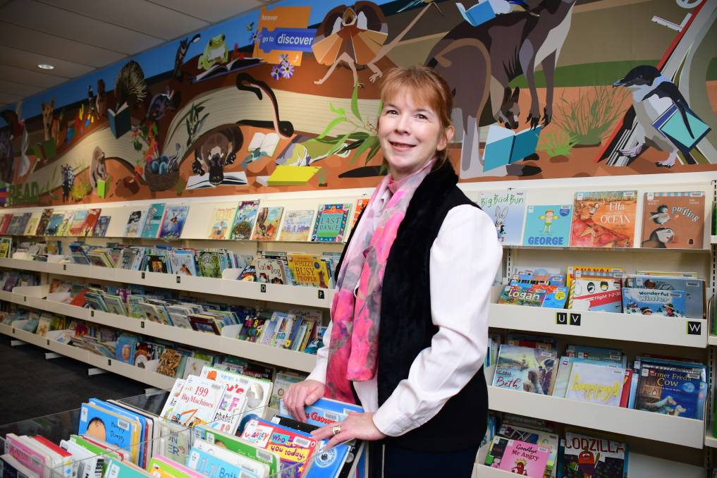 ENCOURAGING READING: Macquarie Regional Library manager Kathryn McAlister says the challenge is just one of the fun things happening at the library this summer. Photo: BELINDA SOOLE